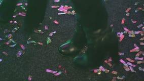 Two beautiful girls dancing on dancefloor, enjoying nightlife. Nightclub party. Stock footage stock video footage