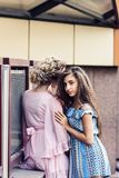 Two beautiful girls of different nationalities are hugging royalty free stock photos