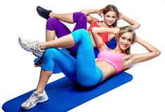 Two girls doing abdominal exercise Stock Photography