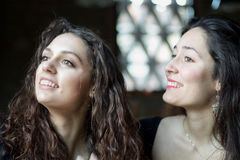 Two beautiful girls doing self portrait. Two beautiful girls smiling doing self portrait Stock Photos