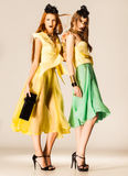 Two beautiful girls dressed in summer dresses Stock Photography