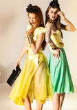 Two beautiful girls dressed in summer dresses Stock Photos