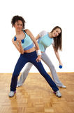 Two beautiful girls exercising with weights Royalty Free Stock Photos