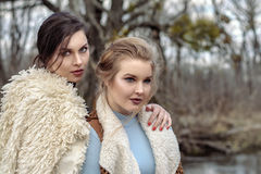 Two beautiful girls in fashionable dress Royalty Free Stock Photography
