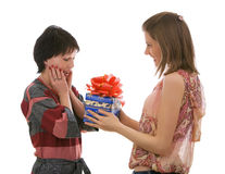 Two beautiful girls with a gift box. Isolated. Royalty Free Stock Photos