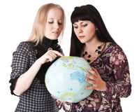 Two beautiful girls with globe Royalty Free Stock Image