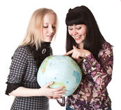 Two beautiful girls with the globe. Isolated on white Stock Image