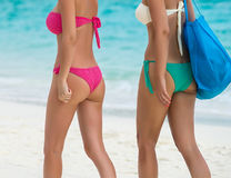 Two beautiful girls going for a tropical beach Stock Image