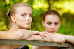Two beautiful girls about handrail Royalty Free Stock Photo