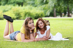 Two beautiful girls hanging in the park Royalty Free Stock Images