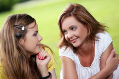 Two beautiful girls hanging in the park Royalty Free Stock Image