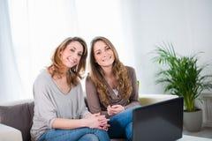 Two beautiful girls having fun at home Stock Photo