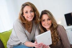 Two beautiful girls having fun at home Stock Image