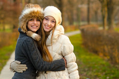 Two beautiful girls having fun outdoor Royalty Free Stock Images