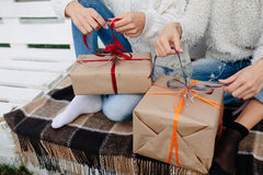 Two beautiful girls holding gifts Royalty Free Stock Photos