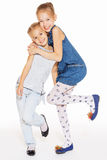 Two beautiful girls hugging. Two cute little girls hugging with a charming smile Stock Photos