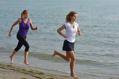 Two beautiful girls jogging / running Stock Photo