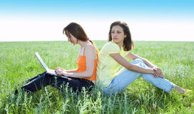 Two beautiful girls with laptop computer Royalty Free Stock Photography