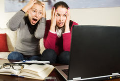 Two beautiful girls with laptop in the office Royalty Free Stock Photography