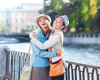 Two beautiful girls laughing and hug in the city Royalty Free Stock Photo