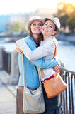 Two beautiful girls laughing and hug in the city. Outdoor Royalty Free Stock Photo