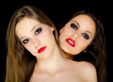 Two beautiful girls with long hair Royalty Free Stock Images