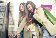 Two beautiful girls making shopping Royalty Free Stock Photos