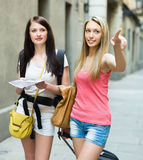 Two beautiful girls with map Stock Images