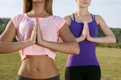 Two beautiful girls meditating outdoors Royalty Free Stock Photo