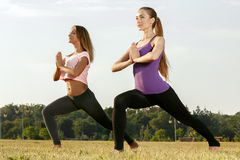 Two beautiful girls meditating outdoors Stock Photography