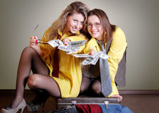 Two beautiful girls with money Royalty Free Stock Photo