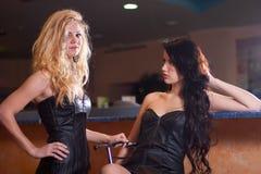 Two beautiful girls near the bar Stock Photos