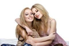 Two beautiful girls in night wear Stock Image