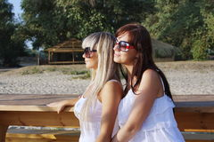 Free Two Beautiful Girls On A Bench Stock Photos - 16065743