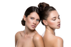 Two beautiful girls with perfect skin Royalty Free Stock Images