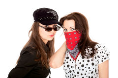 Two beautiful girls portrayed gangsters. Isolated on white Stock Image