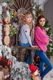 Two beautiful girls posing in Christmas decorations Royalty Free Stock Photo