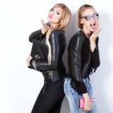 Two beautiful girls posing. Stock Photos