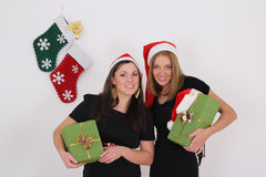 Two beautiful girls with presents Stock Photo
