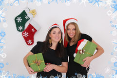 Two beautiful girls with presents Stock Image