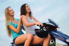 Two beautiful girls riding motorcycle Stock Photography