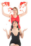Two beautiful girls with rose petals Stock Photography