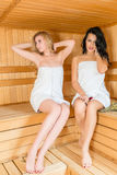 Two beautiful girls in the sauna royalty free stock photography