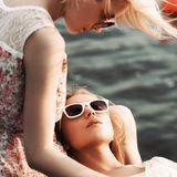 Two beautiful girls at sea pier Royalty Free Stock Photography