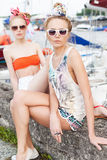 Two beautiful girls at sea pier Royalty Free Stock Photo