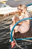 Two beautiful girls at sea pier Stock Photo