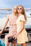 Two beautiful girls at sea pier Stock Image
