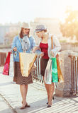 Two beautiful girls with shopping bags Royalty Free Stock Photos