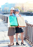 Two beautiful girls with shopping bags in the city Royalty Free Stock Photo