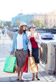Two beautiful girls with shopping bags and cup of coffee Royalty Free Stock Photography